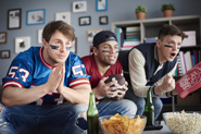 A group of men are dressed in american football shirts