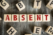 Letter blocks spelling out the word absent