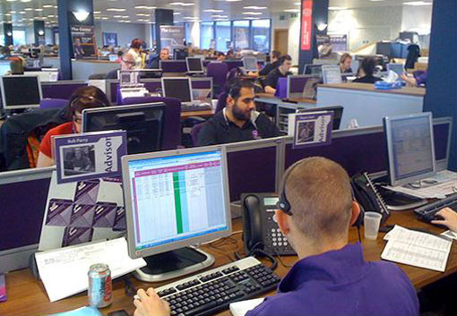 View of the British Gas call centre. Note the purple shirts and chairs as well as the personality type badge on the left.