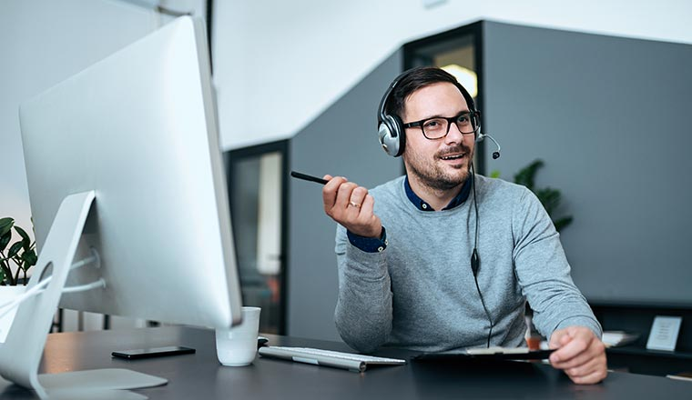 Young customer support executive working in modern office.