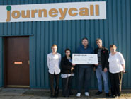 Journeycall present the cheque