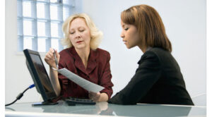 Two people conducting a job appraisal