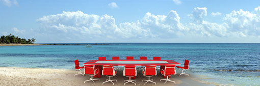 board room table and chairs on a beach