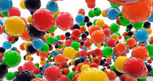 big coloured balls floating in a room