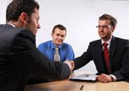 men shaking hands at an interview