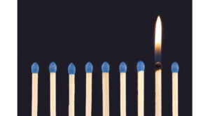 row of matches with one lit