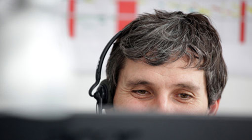 guy with headset on looking very comfortable on call