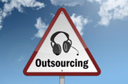 sign with outsourcing and headset on it