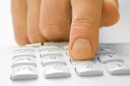 finger pressing phone keypad
