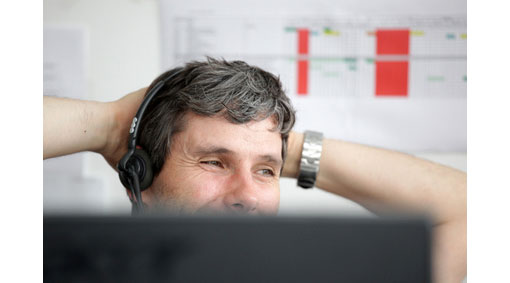 man wearing headset talking in relaxed manner