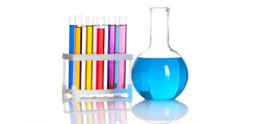 a number of test tubes with coloured water in them