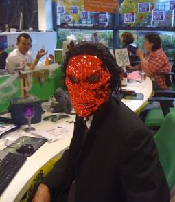 man wearing a scary orange mask
