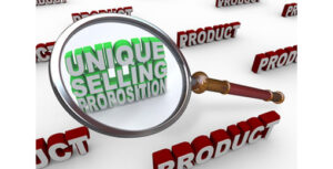 magnifying glass over the word unique selling propositon and products