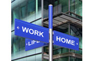 sign post with work, home and life pointing in different directions
