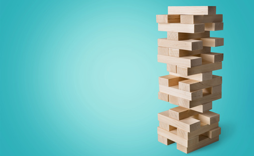 A tower of stacked building blocks like the game jenga