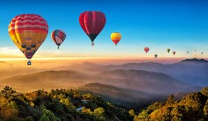 12 hot air balloons in the sky
