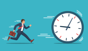 A picture of a businessperson chasing a clock