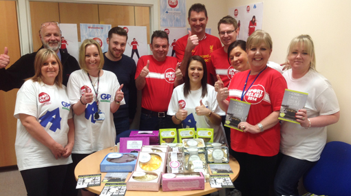 Housing Association contact centre volunteers for Sport Relief host a bake sale