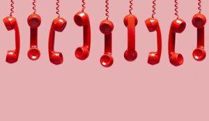 A photo of hung-up phones representing call abandons