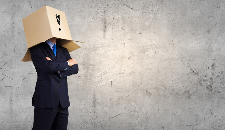 A man has a cardboard box on his head, with an exclamation mark drawn on it