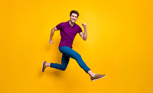 A photo of someone in a happy running pose