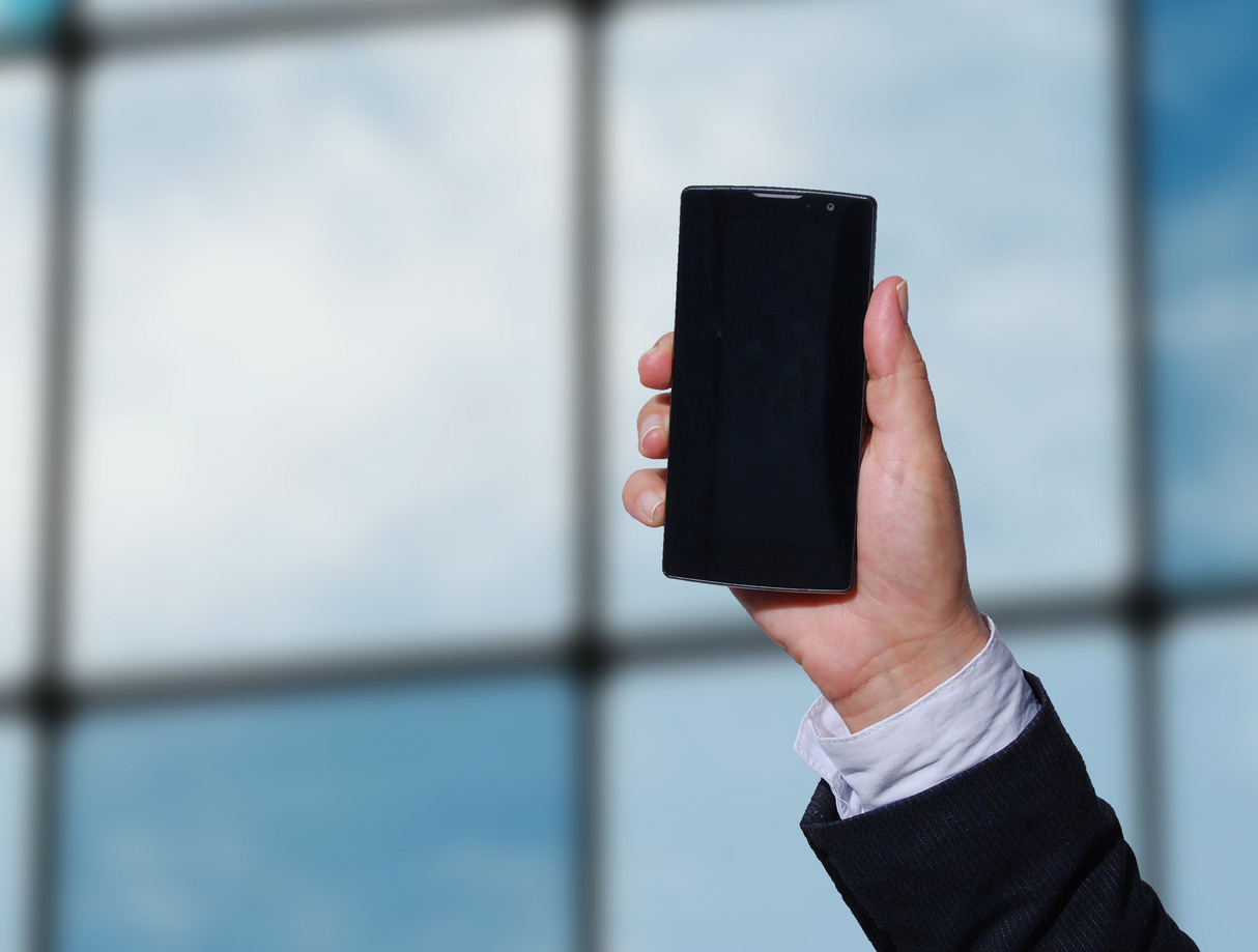 man-holding-mobile-phone