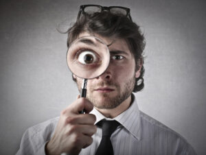 man-with-magnifying-glass-510