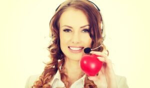 Call centre advisor holding a heart in front of her face