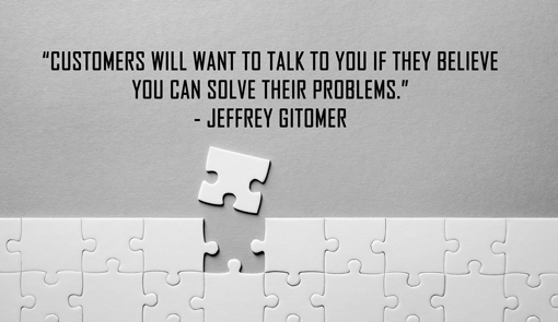 "A puzzle piece falls loose of a jigsaw. Above a quote by Jeffrey Gitomer""Customers will want to talk to you if they believe you can solve their problems""."