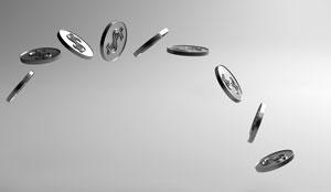 A silver coins flips through the air