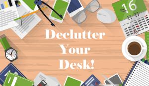 "A graphic of a very cluttered desk, with the words ""declutter your desk"" written across the middle"
