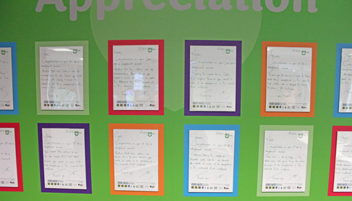 Letters written by the CEO for agents who perform well are displayed on a colourful green background