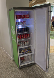 An office fridge with a range of drinks available to the staff