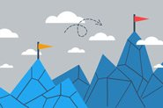 A graphic of two blue mountains. One of the mountains is smaller and has an orange flag on top of it. The second mountain has a red flag atop it. There is a curly arrow between the mountains