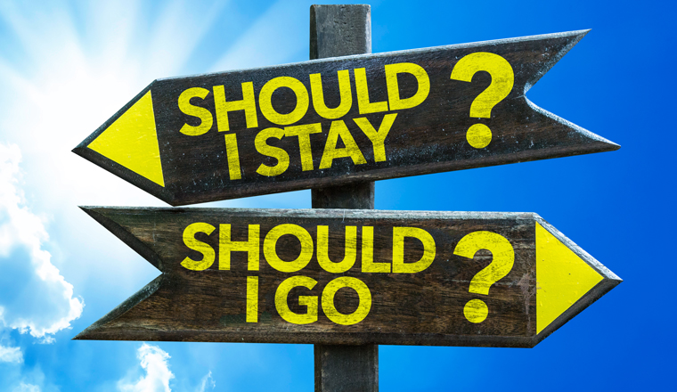 Two sign posts saying, should I stay or Should I go