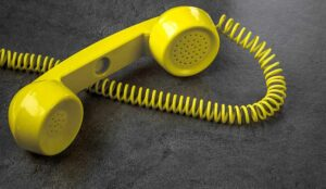 Yellow phone placed down as a result of dead air time on customer service call