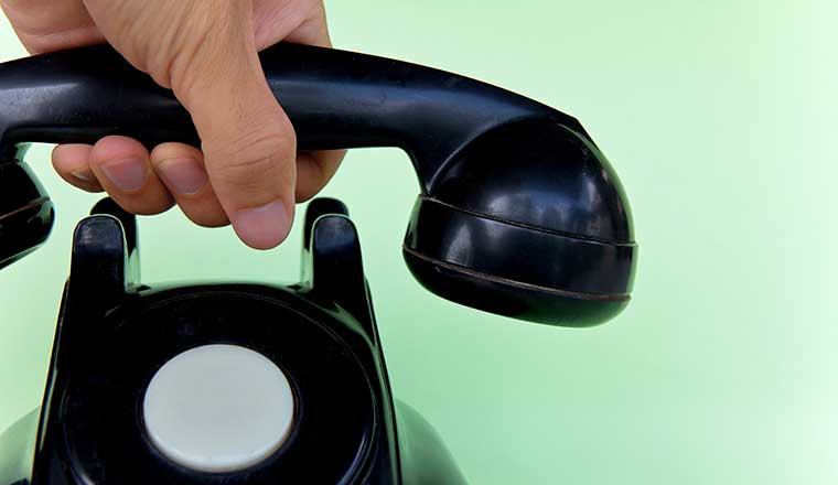 Hand hanging up the phone call closing spiel