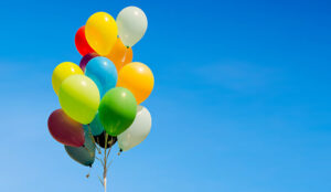 Colourful bunch of helium balloons