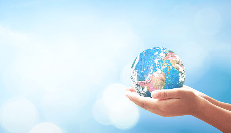 A globe is held in the hands of a child