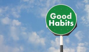 A green sign says good habbits