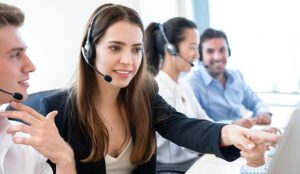 Beautiful businesswoman telemarketing staff working with new coworker team in call center office