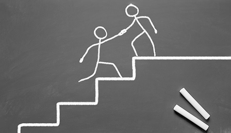 A chalk drawing of a person helping another up the stairs