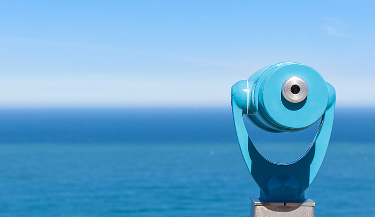 A blue periscope looks over the blue horizon