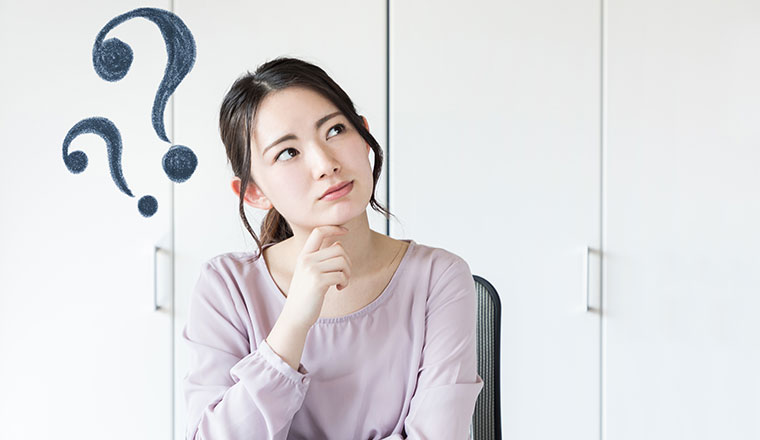 A woman looks puzzled, with question marks hovering over her head