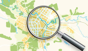 A magnifying glass zooms in on a map