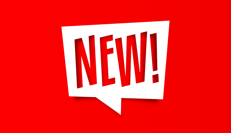 A white sign saying new! in front of a red background