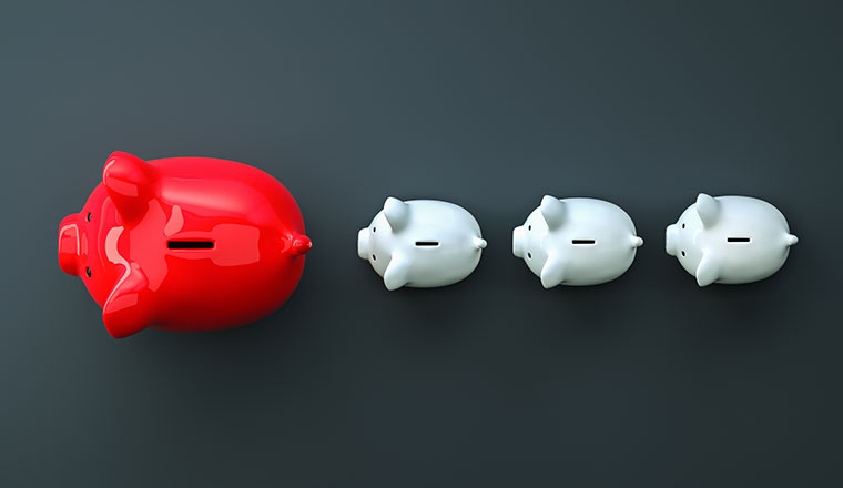 A large red piggy bank is followed by 3 smaller piggy banks