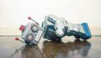 A broken vintage robot has lost his head