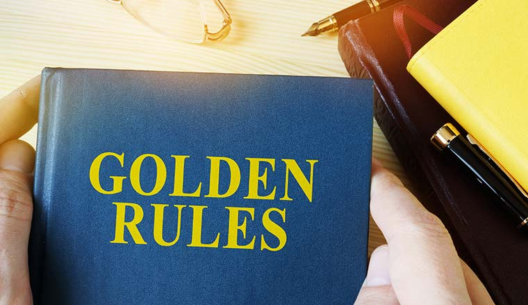 Man holding guide with title golden rules.