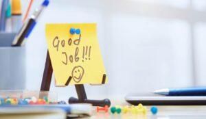 Good job written on a post it note on a desk